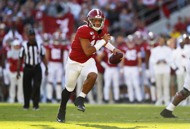 Alabama QB Tua Tagovailoa won't be allowed to run or throw at the NFL scouting combine, but his medical evaluations will be critical. (Photo by Kevin C. Cox/Getty Images)