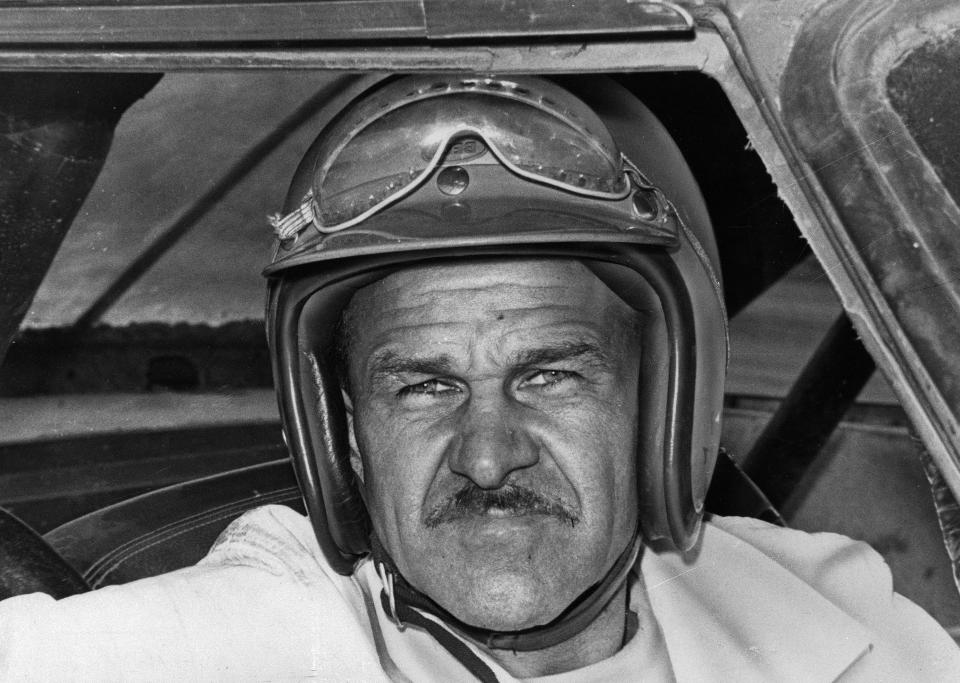 FILE - In this Aug. 1, 1969, file photo, Wendell Scott sits in a race car. Bubba Wallace became just the second Black driver to win at NASCAR's top Cup Series level when rain stopped the playoff race at Talladega Superspeedway. Wallace is the first Black driver to win at NASCAR's elite Cup level since Scott in 1963. (AP Photo/File)