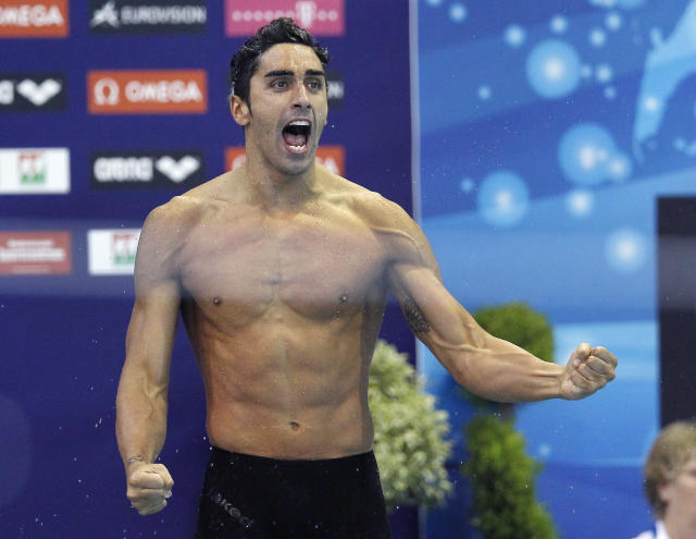 FILE - In this Friday, May 25, 2012 filer, Italy's Filippo Magnini reacts after winning the Men's 100 meter Freestyle final at the European Swimming Championships in Debrecen, Hungary. Two-time swimming world champion Filippo Magnini was cleared of doping and had his four-year ban annulled by the Court of Arbitration for Sport on Thursday, Feb. 27, 2020. I WON. The TAS acquitted me from any kind of accusation, Magnini wrote in a celebratory message on Instagram. It has always been like this, I have always won races in the last few meters. They taught me never to give up. I have always been an athlete and a correct person. I tremble with joy. (AP Photo/ Michael Sohn, File )