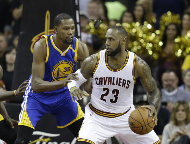 """Paying up for multiple stars like Kevin Durant and <a class=""""link rapid-noclick-resp"""" href=""""/nba/players/3704/"""" data-ylk=""""slk:LeBron James"""">LeBron James</a> isn't always the way to go in DFS. (AP Photo/Tony Dejak, File)"""