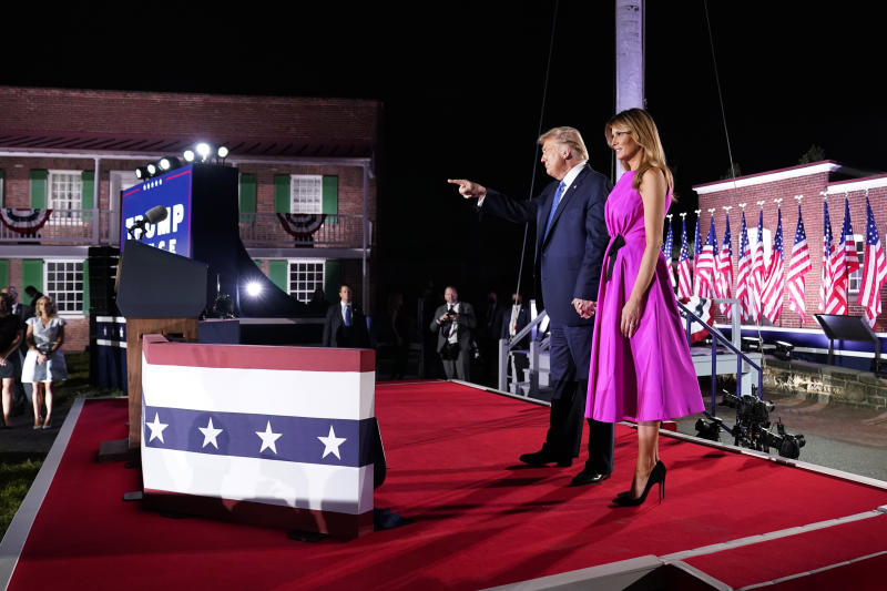 President Donald Trump and first Lady Melania Trump stand on stage on the third day of the Republican National Convention at Fort McHenry National Monument and Historic Shrine in Baltimore, Wednesday, Aug. 26, 2020. (AP Photo/Andrew Harnik)