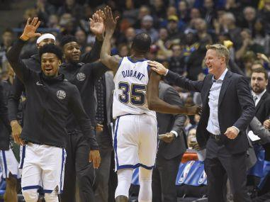 Kevin Durant scored 32 points as the Golden State Warriors overpowered the Cleveland Cavaliers with a late rally to score a 118-108 win in a pulsating clash.