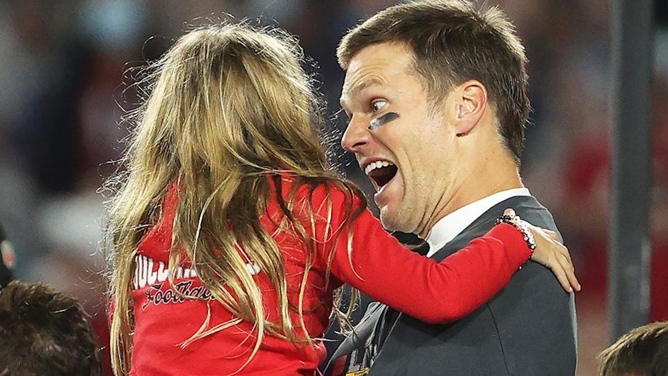 Tom Brady hugs his daughter Vivian after defeating the Kansas City Chiefs 31-9 in Super Bowl LV. (Photo by Patrick Smith/Getty Images)