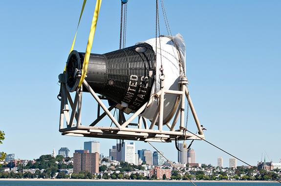 First US Manned Spacecraft Lands at JFK Library in Boston