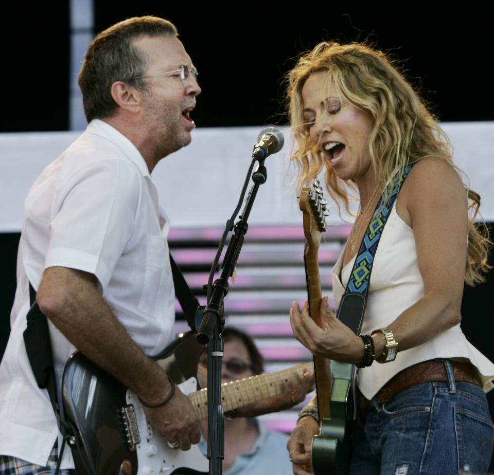 Eric Clapton, left, and Sheryl Crow perform a duet at the Crossroads Guitar Festival in Chicago, Saturday, July 28, 2007. (AP Photo/Charles Rex Arbogast)
