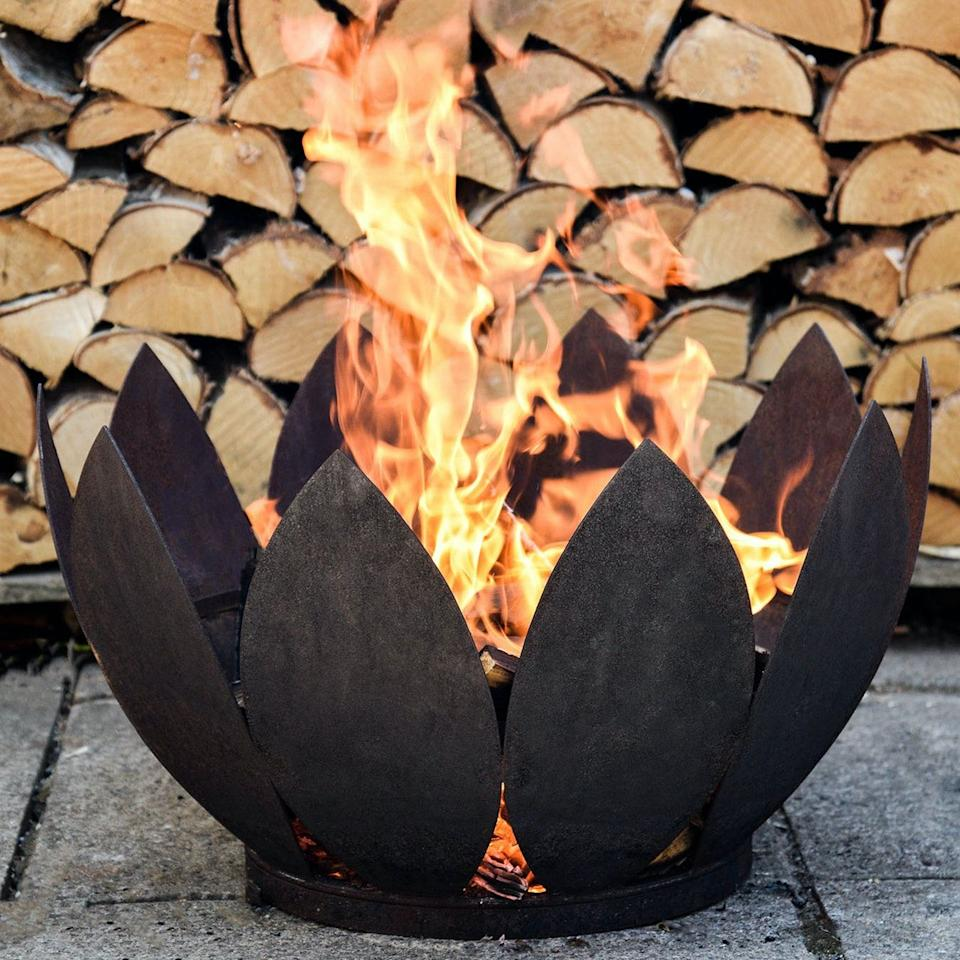 "<p><a class=""body-btn-link"" href=""https://go.redirectingat.com?id=127X1599956&url=https%3A%2F%2Fwww.iamfy.co%2Fproduct%2Fkew-outdoor-fire-pit---black&sref=https%3A%2F%2Fwww.prima.co.uk%2Fhome-ideas%2Fgardening%2Fg32847316%2Foutdoor-fire-pits%2F"" target=""_blank"">SHOP NOW</a></p><p>A really unique leaf-inspired shape, this fire pit is available in black or rust. Crafted from frost-resistant iron, this is a particularly sturdy option and can be left out in the garden all year round. </p>"