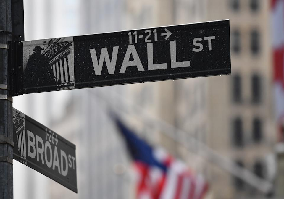 The wall Street street sign is seen on March 23, 2020 in New York City. - Wall Street fell early March 23, 2020 as Congress wrangled over a massive stimulus package while the Federal Reserve unveiled new emergency programs to boost the economy including with unlimited bond buying. About 45 minutes into trading, the Dow Jones Industrial Average was down 0.6 percent at 19,053.17, and the broad-based S&P 500 also fell 0.6 percent to 2,290.31 after regaining some ground lost just after the open. (Photo by Angela Weiss / AFP) (Photo by ANGELA WEISS/AFP via Getty Images)