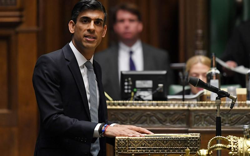 A handout photograph released by the UK Parliament shows Britain's Chancellor of the Exchequer Rishi Sunak delivering his mini-budget in a socially distanced House of Commons in London on July 8, 2020 - Jessica Taylor/AFP