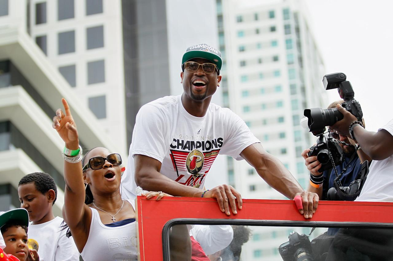 MIAMI, FL - JUNE 25:  Dwyane Wade of the Miami Heat rides in a victory parade through the streets during a celebration for the 2012 NBA Champion Miami Heat on June 25, 2012 in Miami, Florida. The Heat beat the Oklahoma Thunder to win the NBA title.  (Photo by Joe Raedle/Getty Images)