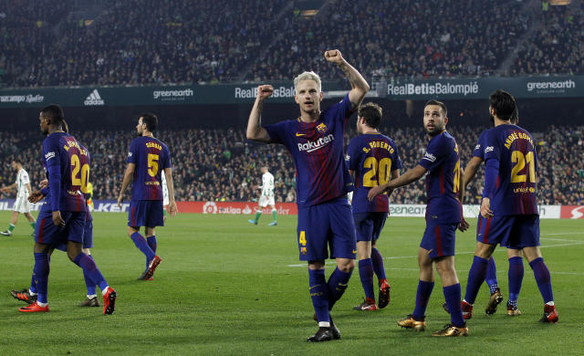 Barcelona's Ivan Rakitic reacts after scoring against Betis during the La Liga soccer match between Barcelona and Betis at the Villamarin stadium, in Seville, Spain on Sunday, Jan. 21, 2018. (AP Photo/Miguel Morenatti)