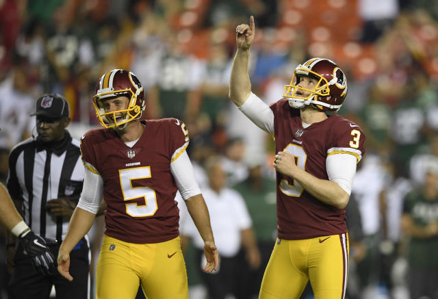 Washington Redskins' Dustin Hopkins (3) celebrates his game-wining field goal next to holder Tress Way (5) during the second half of a preseason NFL football game against the New York Jets, Thursday, Aug. 16, 2018, in Landover, Md. The Redskins won 15-13. (AP Photo/Nick Wass)
