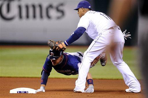 Tampa Bay Rays shortstop Yunel Escobar, right, beats Minnesota Twins' Oswaldo Arcia to the plate for the out at second base as Arcia attempts to advance on the play during the fourth inning of a baseball game Monday, July 8, 2013, in St. Petersburg, Fla. (AP Photo/Brian Blanco)