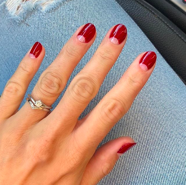 A red velvet half-moon adds a touch of Christmas spirit to your nails, but won't look out of place come January 2.