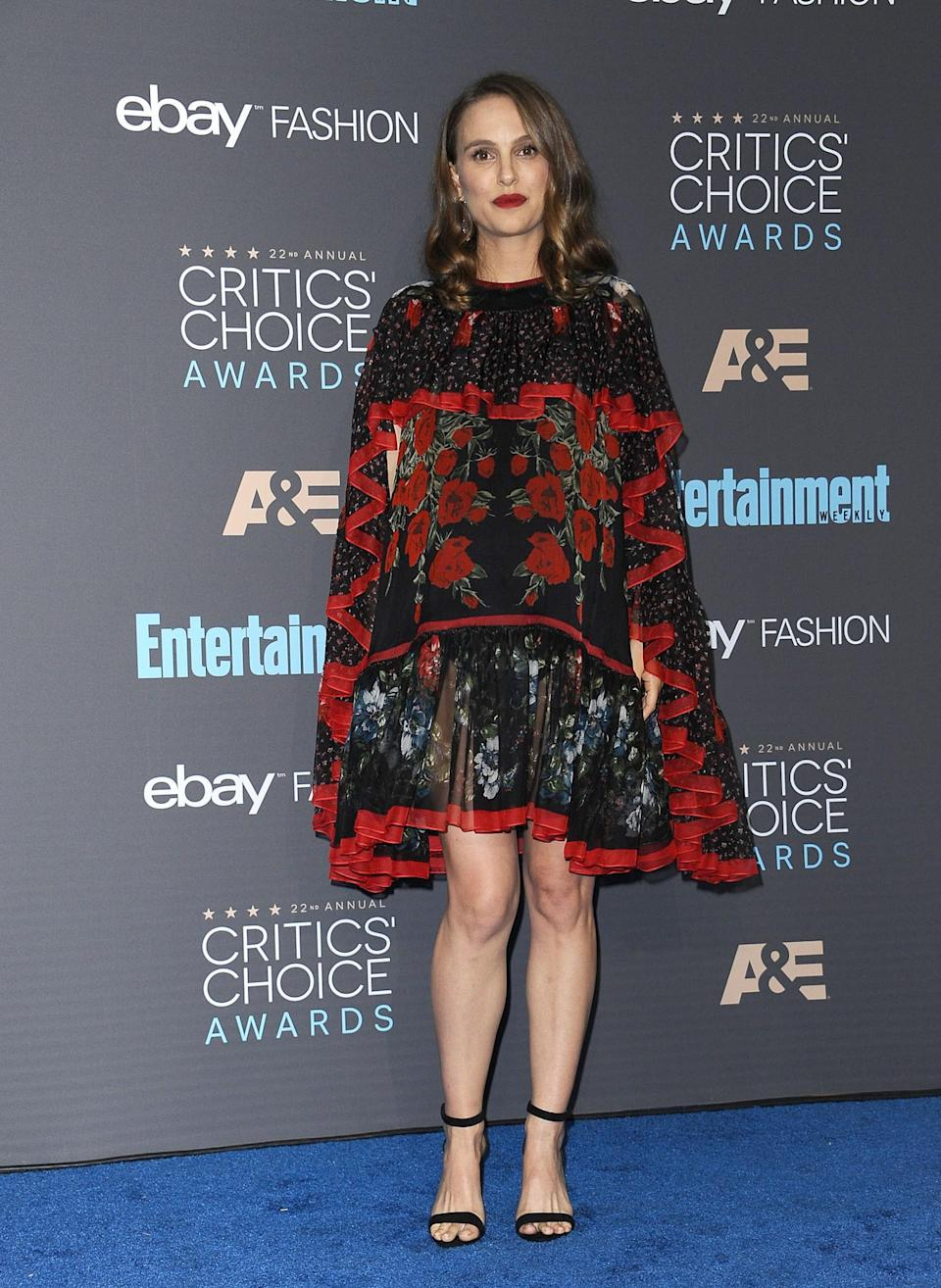 <p>This caped Alexander McQueen dress has to be one of Natalie's best looks of all time. Boasting a tiered design and a striking floral print, it completely took the attention away from the star's bump and was a fantastic style statement. [Photo: Getty] </p>