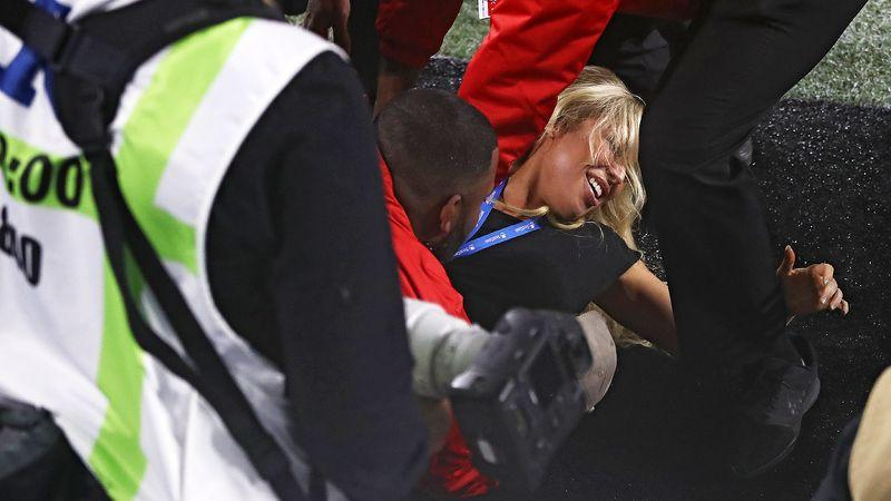 Kelly Kay, pictured here being apprehended by security at the Super Bowl.