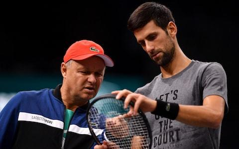 Novak Djokovic of Serbia speaks with coach, Marian Vajda during practice ahead of the Rolex Paris Masters at AccorHotels Arena on October 27, 2018 in Paris, France - Credit:  Getty Images