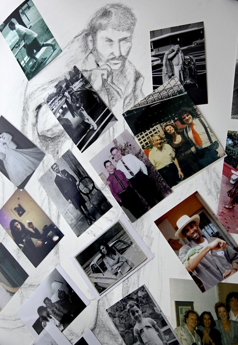 This Aug. 2, 2010 picture shows a few of the photographs Melinda Hunt has acquired while researching people who are buried in New York's Hart Island. The charcoal drawing by Hunt shows Kazimierz Czymanski, who died on Jan. 1, 1998, and was buried in July 1998 on Hart Island. Since 1869, more than 800,000 have been laid to rest at the potter's field on the island that lies in the waters just off the Bronx borough of New York City. (AP Photo/Craig Ruttle)