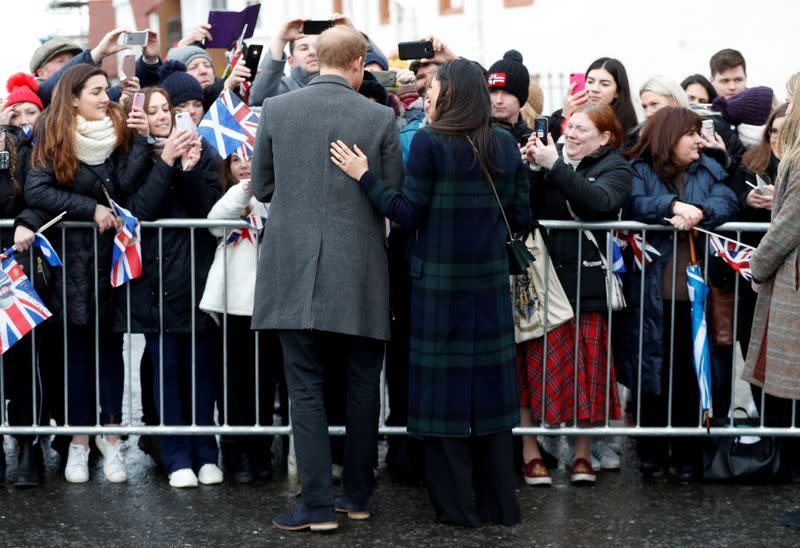 FILE PHOTO: Meghan Markle, and Britain's Prince Harry, meet members of the crowd as they arrive for a visit to Edinburgh