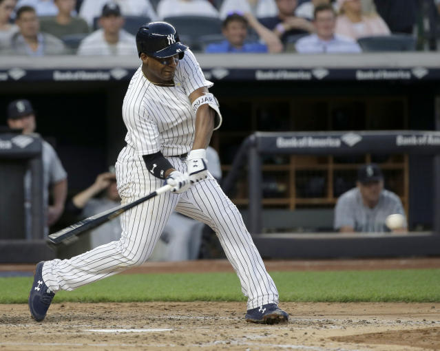 New York Yankees' Miguel Andujar hits a two-run home run during the fifth inning of a baseball game against the Seattle Mariners at Yankee Stadium Tuesday, June 19, 2018, in New York. (AP Photo/Seth Wenig)