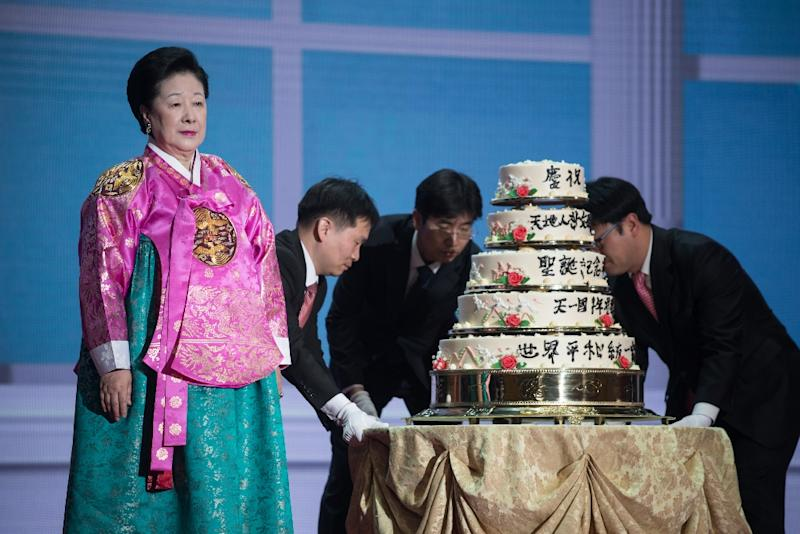 The True Mother, Hak Ja Han (L), the widow of late Unification Church founder Sun Myung Moon, standing beside a cake at a ceremony marking his birthday at the church's global headquarters in Gapyeong (AFP Photo/Ed Jones)
