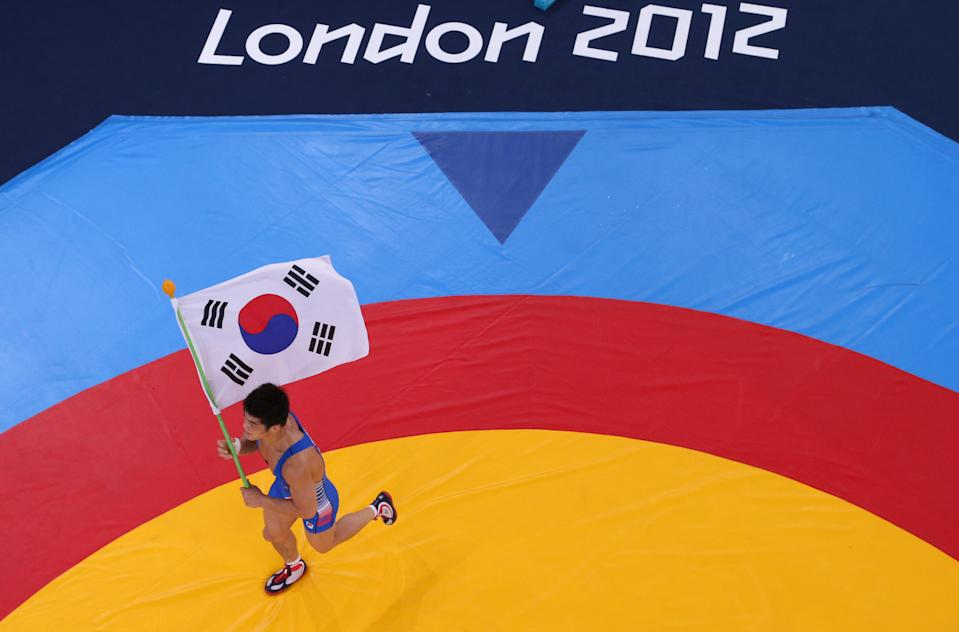 LONDON, ENGLAND - AUGUST 07: Hyeonwoo Kim of Korea celebrates his win in the Men's Greco-Roman 66 kg Wrestling on Day 11 of the London 2012 Olympic Games at ExCeL on August 7, 2012 in London, England. (Photo by Ian Walton/Getty Images)
