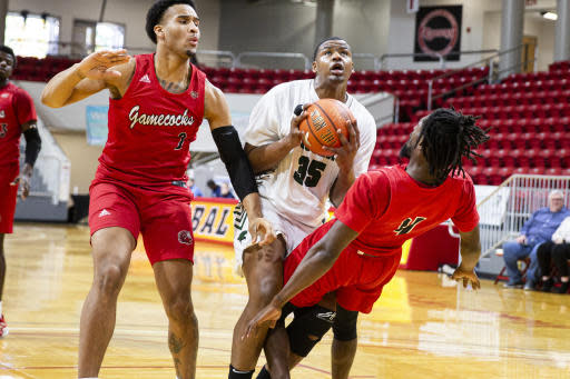 Jacksonville State guard Ty Hudson (4) draws a charge from Chicago State center Solomon Hunt (35) in the first half of an NCAA college basketball game at the Emerald Coast Classic in Niceville, Fla., Friday, Nov. 29, 2019. (AP Photo/Mark Wallheiser)