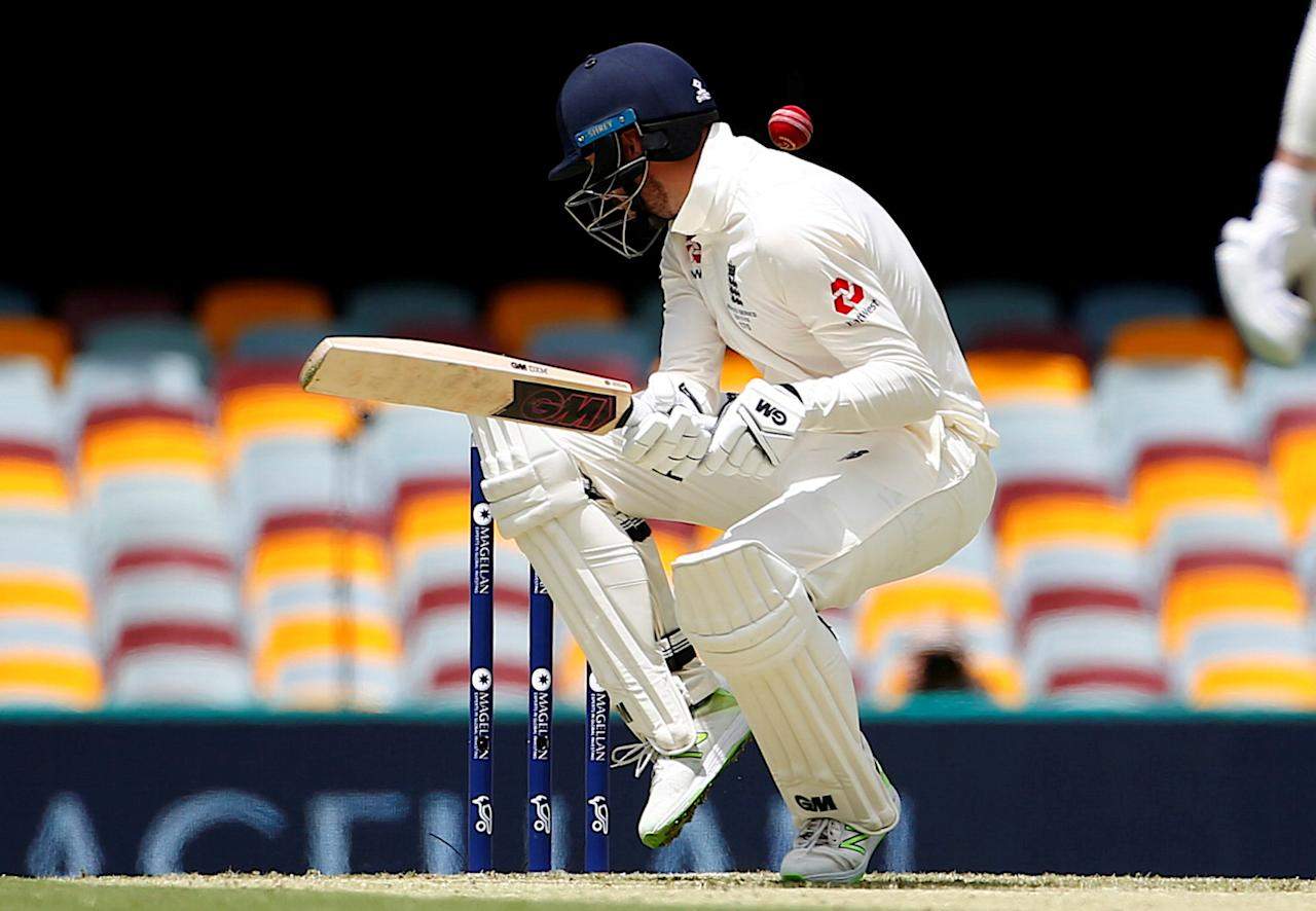 Cricket - Ashes test match - Australia v England - GABBA Ground, Brisbane, Australia, November 23, 2017. England's James Vince avoids a bouncer bowled by Australia's Mitchell Starc during the first day of the first Ashes cricket test match.    REUTERS/David Gray     TPX IMAGES OF THE DAY