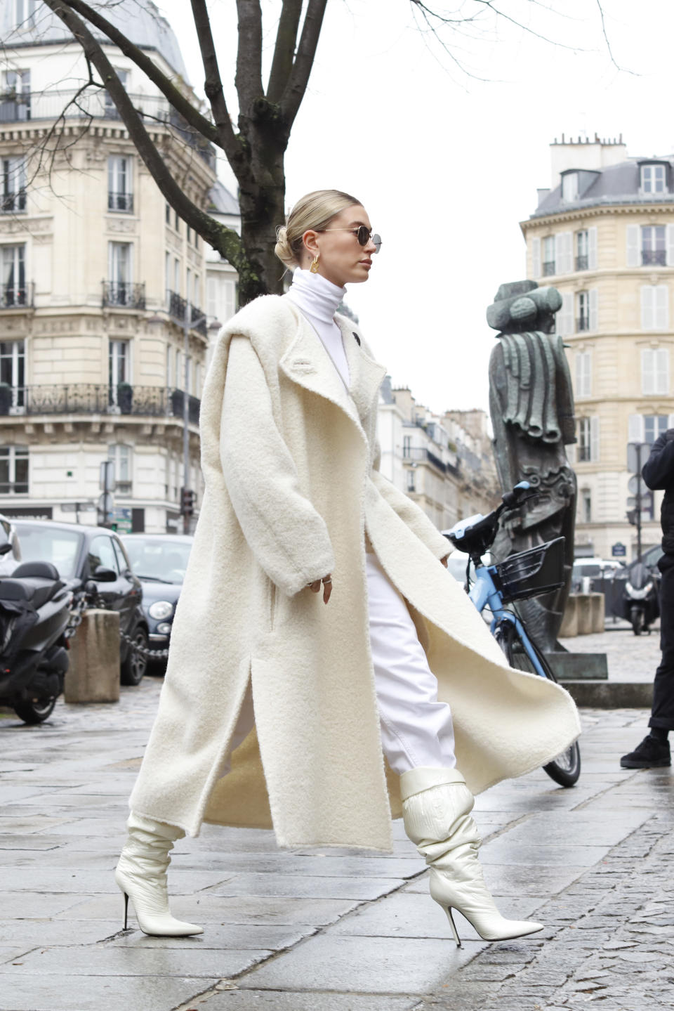Hailey Bieber is seen wearing creme white cardigan, knitted skirt and top, Bottega bag during Paris Fashion Week Womenswear Fall/Winter 2020/2021 : Day Four on February 27, 2020 in Paris, France.  (Photo by Mehdi Taamallah/NurPhoto via Getty Images)