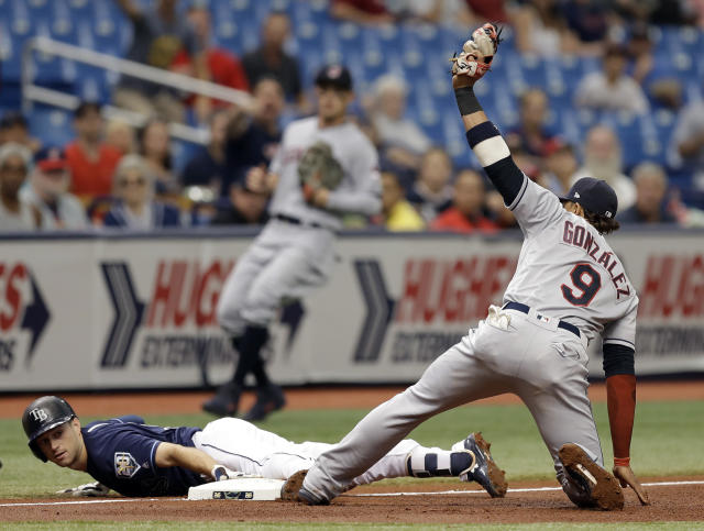 Tampa Bay Rays' Brandon Lowe slides into third base with a triple ahead of the tag by Cleveland Indians' Erik Gonzalez (9) during the fourth inning of a baseball game Wednesday, Sept. 12, 2018, in St. Petersburg, Fla. (AP Photo/Chris O'Meara)