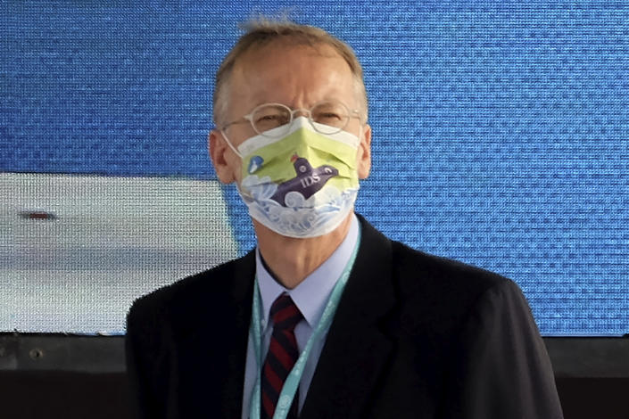Director of the American Institute in Taiwan, Brent Christensen wears a mask with the design showing Taiwan's domestic submarine as he attends a ceremony to inaugurate the production of these submarines at the CSBC Corp's shipyards in the southern city of Kaohsiung, Taiwan on Tuesday, Nov. 24, 2020. Taiwan's President Tsai Ing-wen inaugurated the production of domestically-made submarines Tuesday in the southern city of Kaohsiung, in a step forward for the island's defense strategy at a time of elevated tensions with China. (AP Photo/Huizhong Wu)