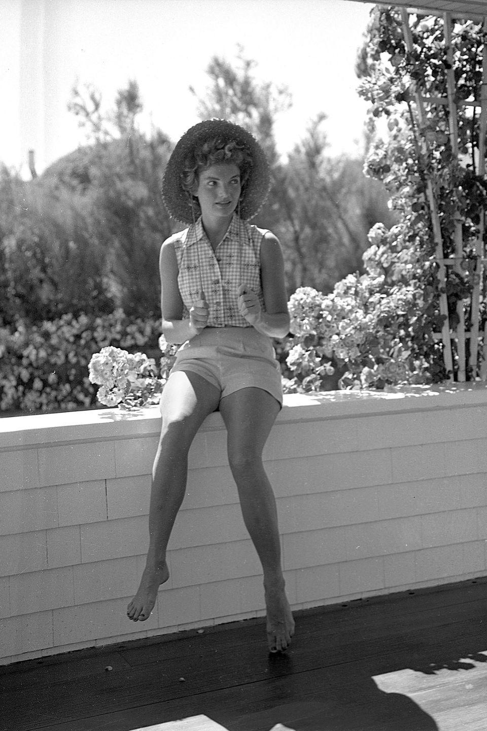 <p>It's all about chic shorts and a little button-down while vacationing at the Kennedy compound in Massachusetts in 1953. That straw topper just adds to the easy, breezy summer vibe.</p>