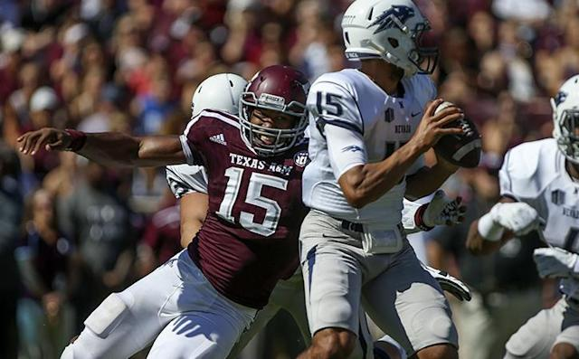 Sep 19, 2015; College Station, TX, USA; Texas A&M Aggies defensive lineman Myles Garrett (15) sacks Nevada Wolf Pack quarterback Tyler Stewart (15) during the first quarter at Kyle Field. Mandatory Credit: Troy Taormina-USA TODAY Sports