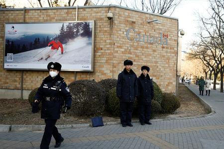 Police keep watch outside the embassy of Canada in Beijing, China, December 12, 2018.  REUTERS/Thomas Peter