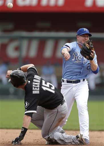 Kansas City Royals second baseman Elliot Johnson, right, throws to first too late for the double play on a single hit by Chicago White Sox's Alejandro De Aza after forcing White Sox's Gordon Beckham (15) out at second during the second inning of a baseball game on Sunday, June 23, 2013, in Kansas City, Mo. (AP Photo/Charlie Riedel)