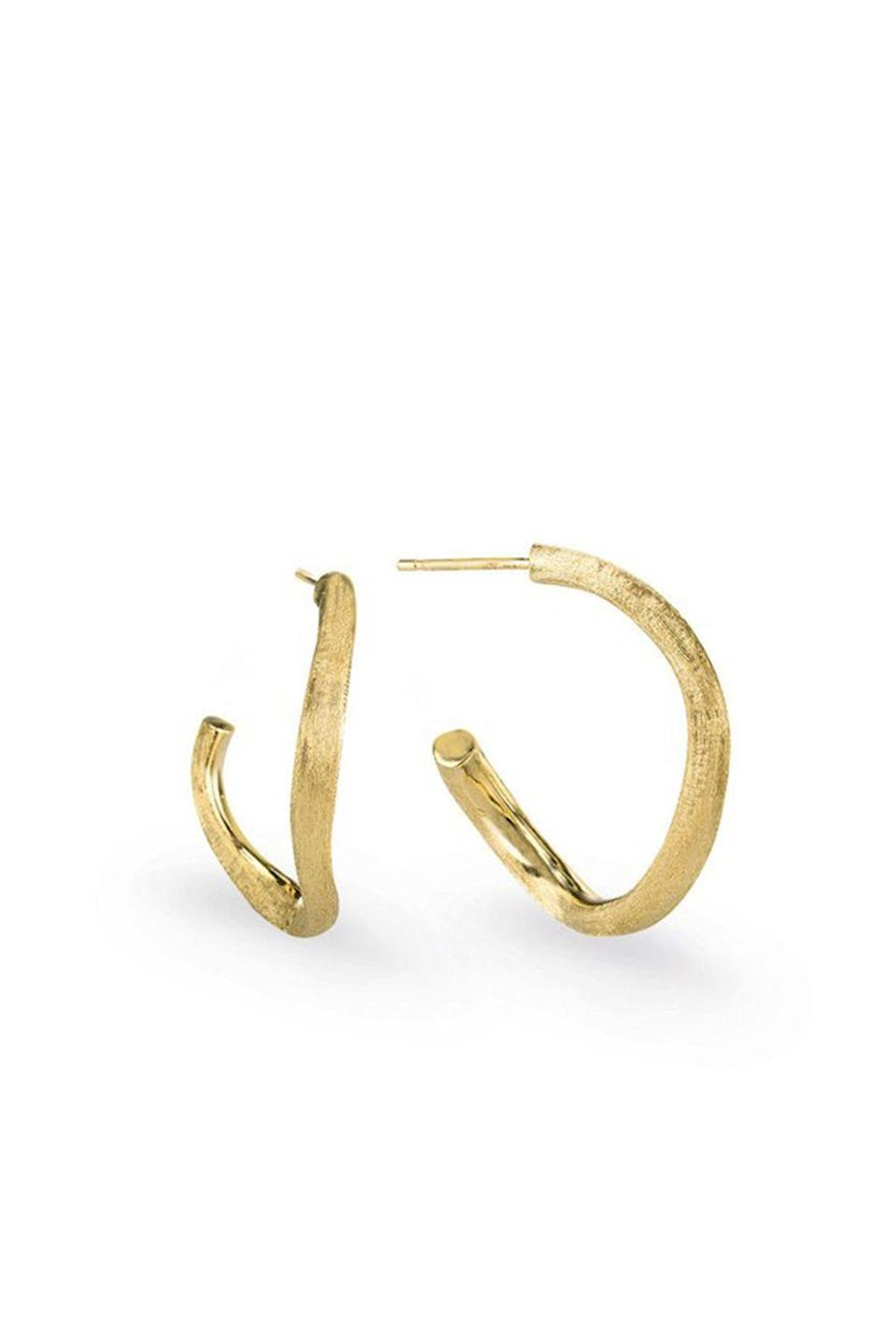 """<p><strong>Marco Bicego</strong></p><p>marcobicego.com</p><p><strong>$965.00</strong></p><p><a href=""""https://us.marcobicego.com/products/jaipur-gold-hoop-earrings-ob1469y02"""" rel=""""nofollow noopener"""" target=""""_blank"""" data-ylk=""""slk:Shop Now"""" class=""""link rapid-noclick-resp"""">Shop Now</a></p><p>Marco Bicego's minimalist take on glamour is evident in these winding solid gold hoops.</p>"""