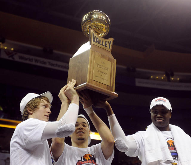 From left, Wichita State's Ron Baker, Fred VanVleet and Cleanthony Early celebrate with the trophy after their victory over Indiana State in an NCAA college basketball game in the championship of the Missouri Valley Conference men's tournament, Sunday, March 9, 2014, in St. Louis. (AP Photo/Bill Boyce)