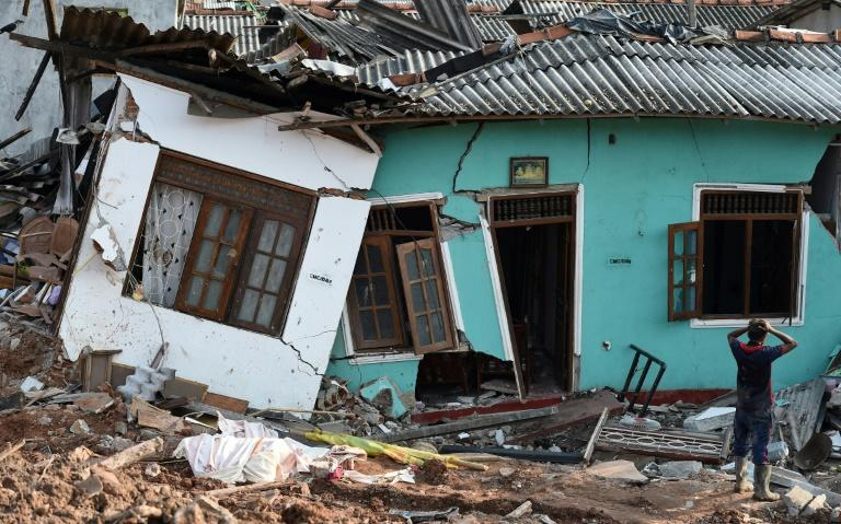 Some 145 homes were destroyed when the 300-foot (90-metre) rubbish mountain came crashing down and police say many more buildings were damaged and could collapse at any time