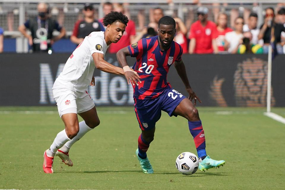 USMNT defender Shaq Moore (20) controls the ball as Canada's Tajon Buchanan defends during Concacaf Gold Cup Soccer group play at Children's Mercy Park in Kansas City.