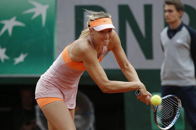 Russia's Maria Sharapova returns the ball during the third round match of the French Open tennis tournament against Argentina's Paula Ormaechea at the Roland Garros stadium, in Paris, France, Friday, May 30, 2014. (AP Photo/Michel Euler)