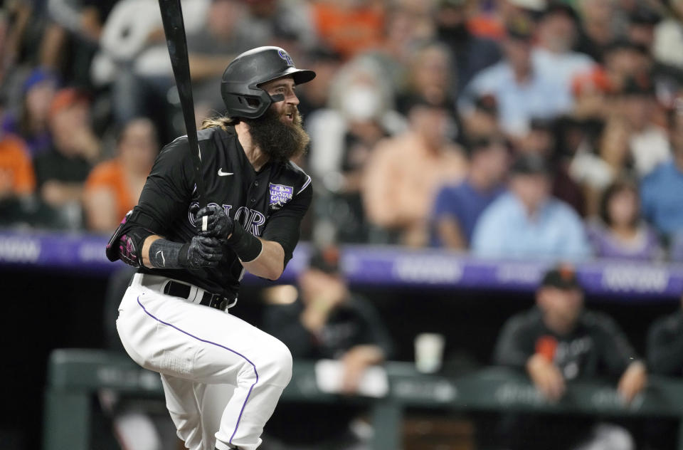Colorado Rockies' Charlie Blackmon singles against San Francisco Giants starting pitcher Anthony DeSclafani in the third inning of a baseball game Saturday, Sept. 25, 2021, in Denver. (AP Photo/David Zalubowski)