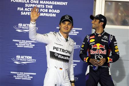 Mercedes Formula One driver Nico Rosberg (L) of Germany celebrates taking pole position next to Red Bull Formula One driver Daniel Ricciardo of Australia after the qualifying session of the Bahrain F1 Grand Prix at the Bahrain International Circuit (BIC) in Sakhir, south of Manama April 5, 2014. REUTERS/Hamad I Mohammed