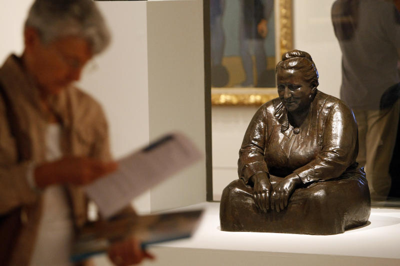 "A member of the media stands  next a 1923 sculpture by American artist Jo Davidson: ""Gertrude Stein"", on the eve of the opening of the exhibition: Matisse, Cezanne, Picasso, L'aventure des Stein, at the Grand Palais in Paris, Tuesday Oct. 4, 2011.(AP Photo/Remy de la Mauviniere)"