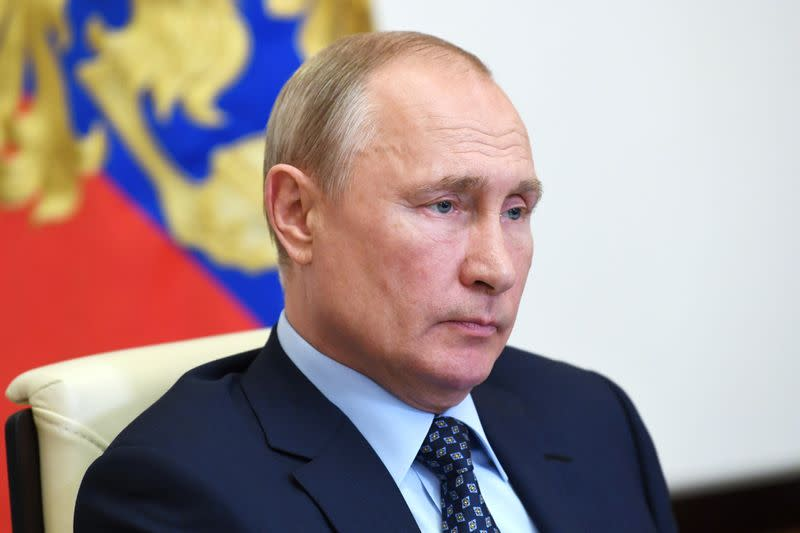 Russian President Putin delivers a televised address to the nation about the coronavirus disease outbreak, outside Moscow