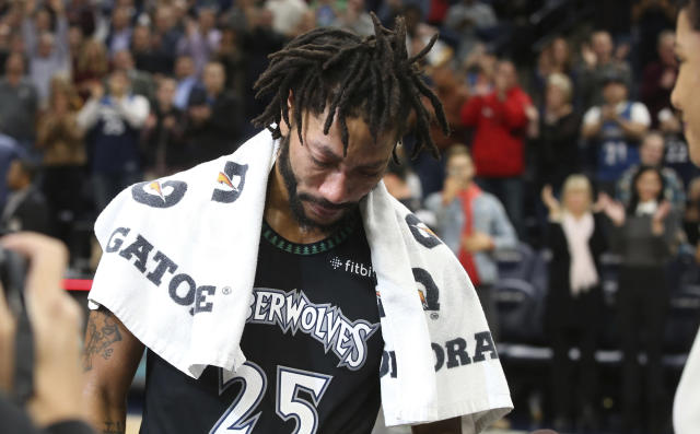 """<a class=""""link rapid-noclick-resp"""" href=""""/nba/players/4387/"""" data-ylk=""""slk:Derrick Rose"""">Derrick Rose</a> tries to compose himself after scoring a career-high 50 points against the Utah Jazz on Wednesday night. (AP)"""