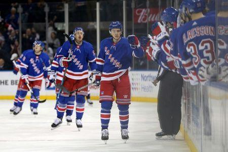 Nov 24, 2018; New York, NY, USA; New York Rangers left wing Jimmy Vesey (26) celebrates with teammates after scoring a goal against the Washington Capitals during the first period at Madison Square Garden. Mandatory Credit: Brad Penner-USA TODAY Sports