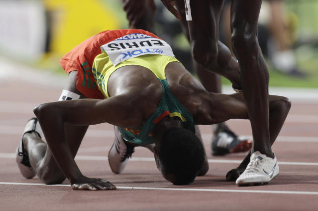 Muktar Edris, of Ethiopia reacts after winning the gold medal in the men's 5000 meter final at the World Athletics Championships in Doha, Qatar, Monday, Sept. 30, 2019. (AP Photo/Petr David Josek)