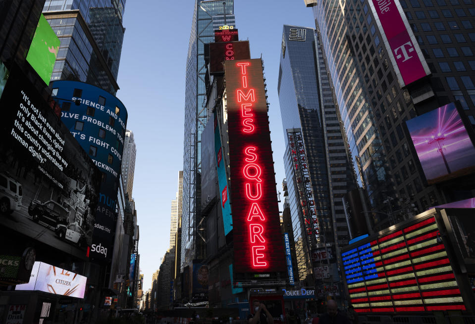 FILE - This Aug. 5 ,2020, file photo shows One Times Square, center, in New York's Times Square. For decades the GOP and business have shared common ground, especially with their mutual belief in low taxes and the need to repeal regulations. But the relationship has come under increasing pressure as companies take cultural stands and other interests diverge. (AP Photo/Mark Lennihan, File)