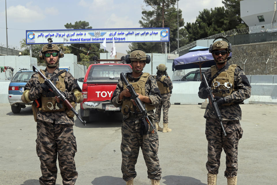FILE - In this Tuesday, Aug. 31, 2021 file photo, Taliban special forces fighters stand guard outside the Hamid Karzai International Airport after the U.S. military's withdrawal, in Kabul, Afghanistan. The Taliban, which is in need of foreign aid, has said it will allow people with valid travel papers to leave, and the international community says it will be monitoring to see if they keep their word. (AP Photo/Khwaja Tawfiq Sediqi)