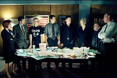 "The forces of good and evil - L-R: Scully (Gillian Anderson), Byers (Bruce Harwood), Langly (Dean Haglund), Mulder (David Duchovny), Krycek (Nicholas Lea), Marita Covarrubias (Laurie Holden), Frohike (Tom Braidwood) and Skinner (Mitch Pileggi) - join together to discuss a case in the ""Requiem"" episode of Fox's The X-Files X-Files"