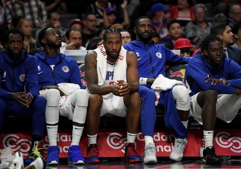 LOS ANGELES, CALIFORNIA - OCTOBER 10: Kawhi Leonard #2 of the LA Clippers on the bench after playing the first half during a 111-91 Denver Nuggets preseason win at Staples Center on October 10, 2019 in Los Angeles, California. (Photo by Harry How/Getty Images)